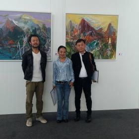 Oceněná dvojice (Huang Zhuojun) s Tetsem Ohnarim